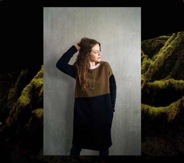 Sukienka z MCHU. Ciepła sukienka z dzianiny w kolorze zgniłej zieleni, geometrycznie łączonej z czarną dzianiną.Polski Handmade.